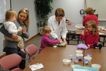 Girls Play with Paper Mache at the Public Library