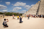 Tourists posing for pictures at Chichén Itza, Yucatán March 10, 2018