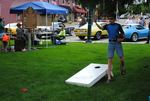 Child Plays Cornhole Near Mary Ann Ball Historical Marker During First Friday in Mount Vernon
