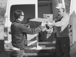 Loading Yellowbird Foodshed Deliveries by Bryant Brothers Creative